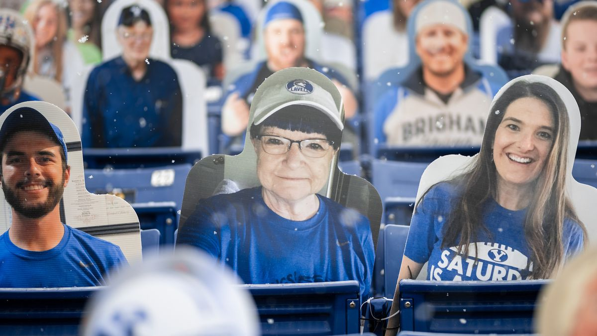 A cutout of Pam Woodall, center, is among the many set up at LaVell Edwards Stadium on Friday, Dec. 11, 2020. After Woodall died of cancer before the start of the BYU football season this year, her daughter, Kelli Gard, and her husband, Randy Woodall, submitted photos of her to BYUto be included among the cutouts.