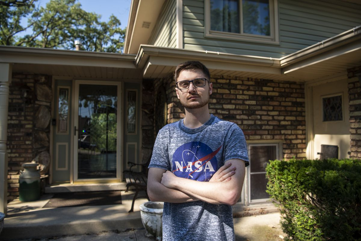 Dean Darhussein a undergraduate majoring in physics at the University of Illinois at Urbana-Champaign stands in front of his Tinley Park home, Wednesday, Aug. 12, 2020. Darhussein like many college students will be staying home and taking classes online amid the coronavirus pandemic. | Tyler LaRiviere/Sun-Times