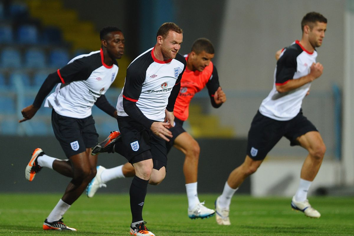 PODGORICA, MONTENEGRO - OCTOBER 06: Wayne Rooney of England sprints in front of Danny Welbeck, Kyle Walker and Gary Cahill during traininig at the City Stadium on October 6, 2011 in Podgorica, Montenegro.  (Photo by Laurence Griffiths/Getty Images)