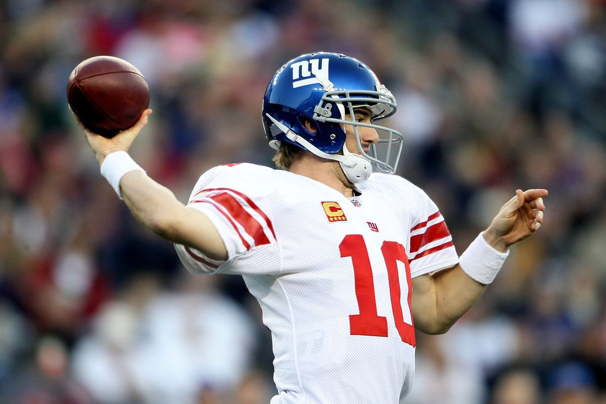 FOXBORO, MA - NOVEMBER 06:  Eli Manning #10 of the New York Giants throws the ball during the first quarter against the New England Patriots at Gillette Stadium on November 6, 2011 in Foxboro, Massachusetts.  (Photo by Elsa/Getty Images)