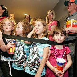 """From left: Chloe Whittington, Kali Ford, Leah Knighton and Mikele Knighton wait in line Friday for the movie """"Hannah Montana,"""" at the Megaplex 20 in South Jordan."""