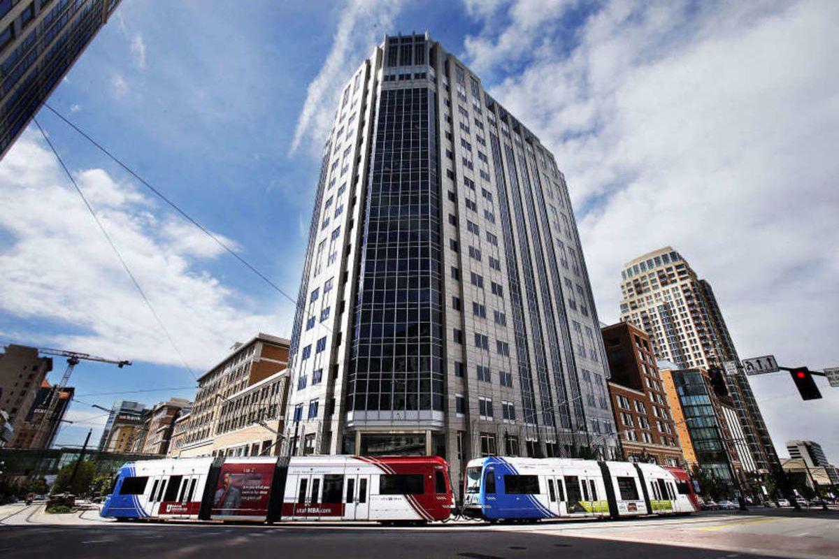A TRAX train travels trough downtown Salt Lake City, Monday, Aug. 25, 2014.