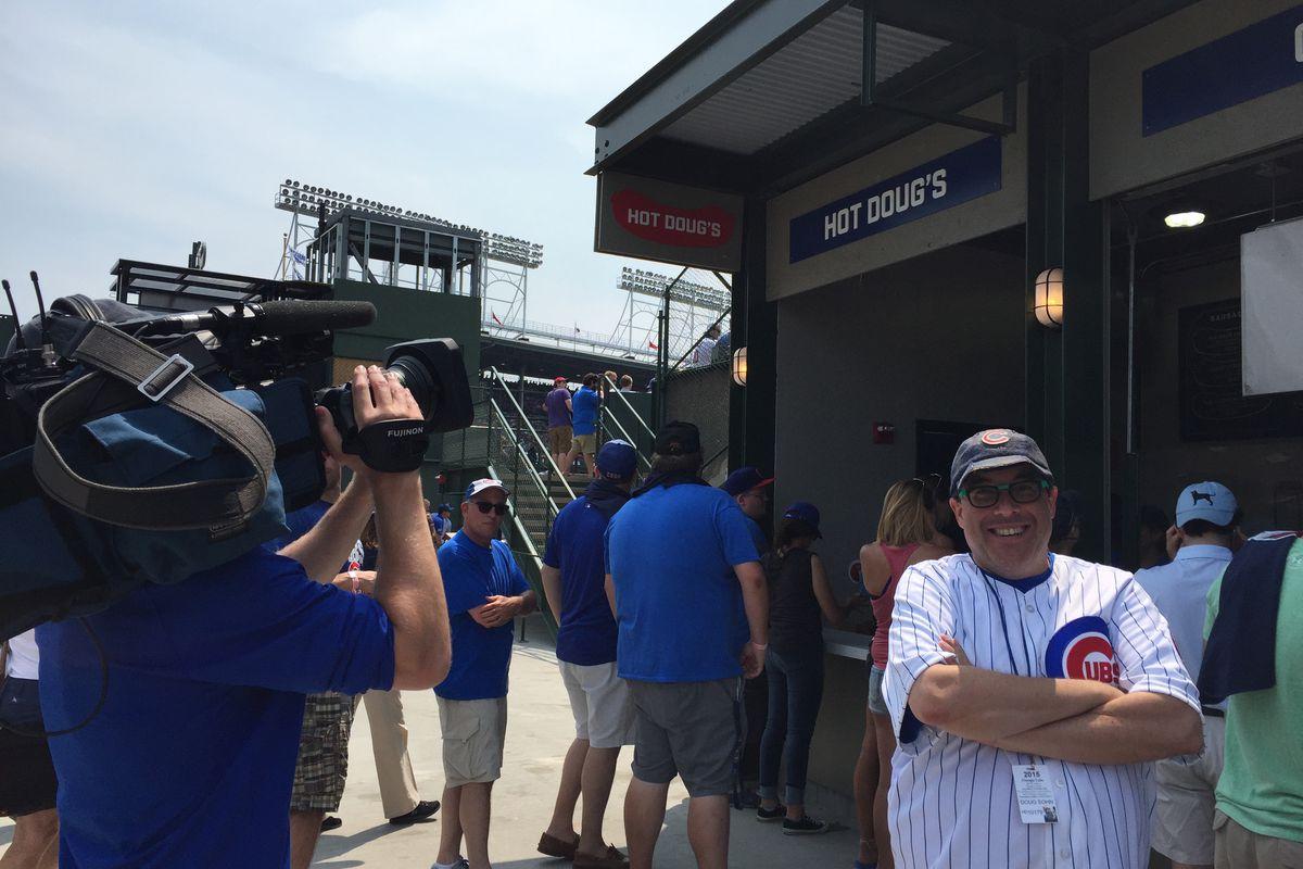 Doug Sohn next to Hot Doug's bleacher location at Wrigley Field.