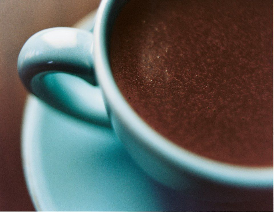 A close up of part of a cup of hot chocolate.