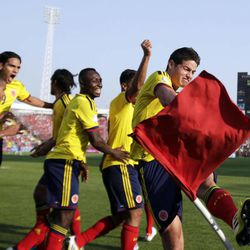 Colombia's James Rodriguez, right, celebrates a play along with teammates during a World Cup 2014 qualifying soccer game with Chile in Santiago, Chile, Tuesday, Sept. 11, 2012.