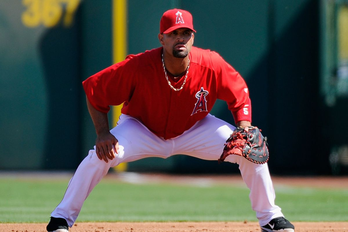 TEMPE, AZ - MARCH 12:  Albert Pujols #5 of the Los Angeles Angels of Anaheim peers into the bright future of the franchise.