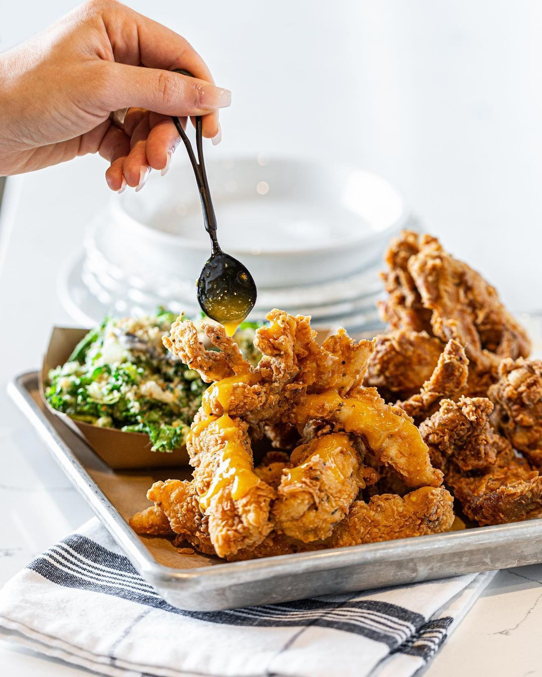 Duck fat fried chicken served on a metal tray lined with paper