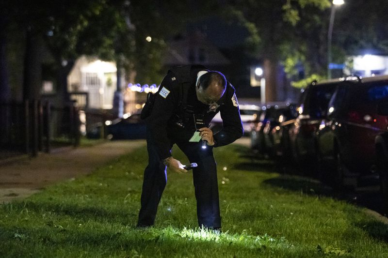 Chicago police investigate in the 3700 block of West McLean Avenue in Logan Square, where authorities said a 29-year-old man was shot multiple times Saturday night.