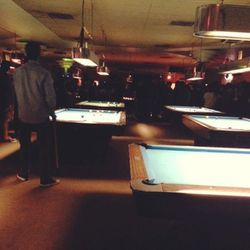 We meet up with some local friends at a newly opened pool hall and bar, The Grand, which has a <i>Dazed and Confused</i> vibe: Longhair metal boys, local babes, lanes of pool tables, and cheap drinks.