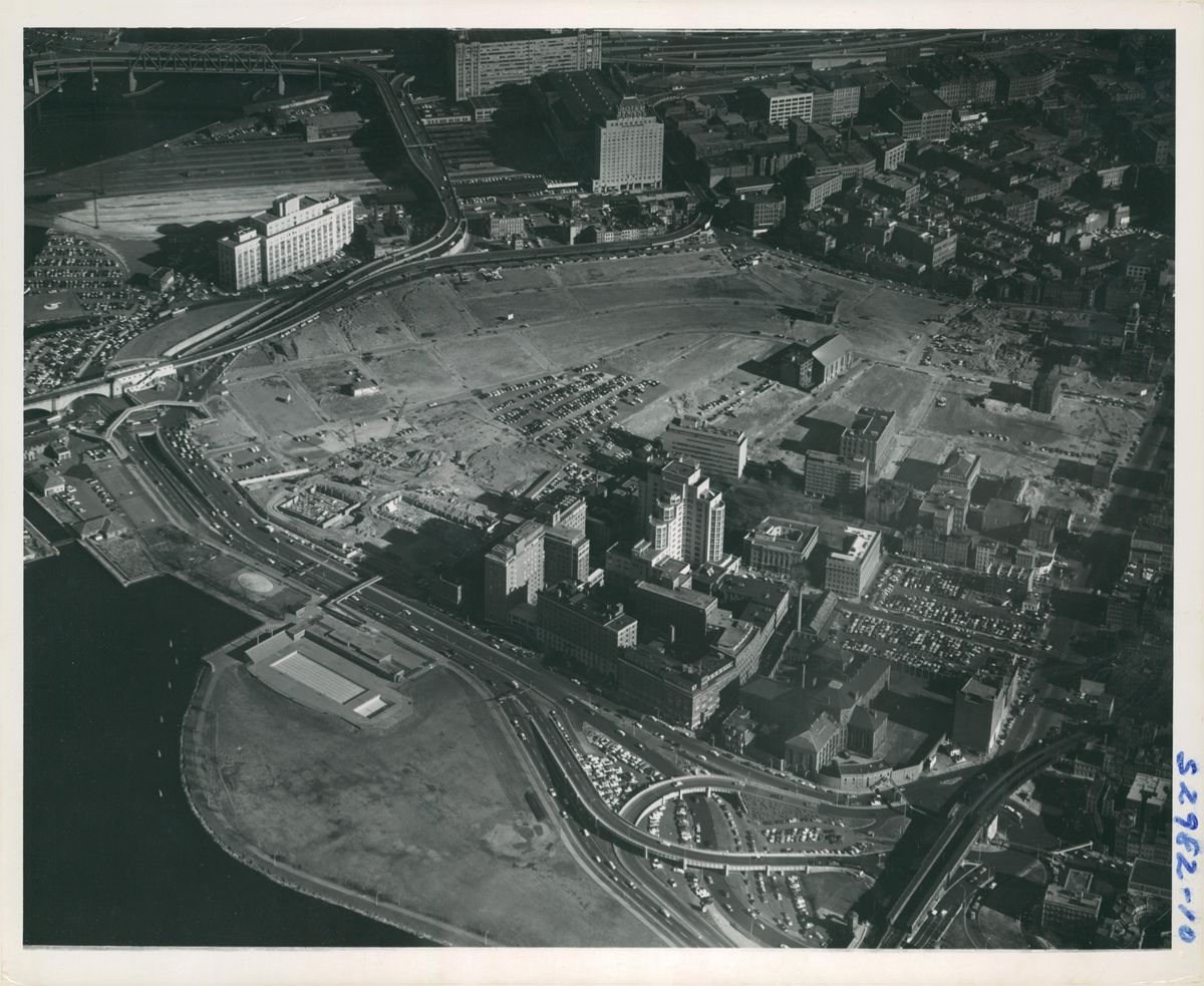 A historic aerial photo of city buildings in Boston.