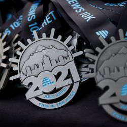 Medals for the Deseret News 10K are prepared for runners at the finish line at Liberty Park in Salt Lake City on Friday, July 23, 2021.