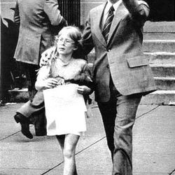 """President Carter escorts his daughter, Amy, as they leave a school after Amy performed in a """"show and tell."""""""