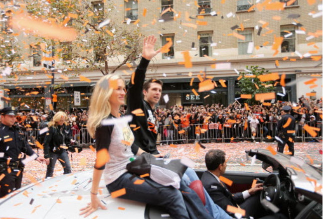 <em>Buster Posey waves to the crowd during the Giants' 2012 parade. It was their second of three parades in five years — without so much as making the playoffs between championships.</em>