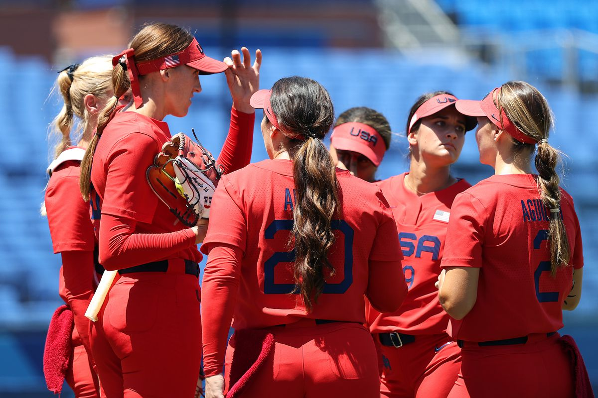 Pitcher Monica Abbott of Team United States (second from left) and teammate huddle together in the sixth inning of the game against Team Australia during the Softball Opening Round on day two of the Tokyo 2020 Olympic Games at Yokohama Baseball Stadium on July 25, 2021 in Yokohama, Kanagawa, Japan.