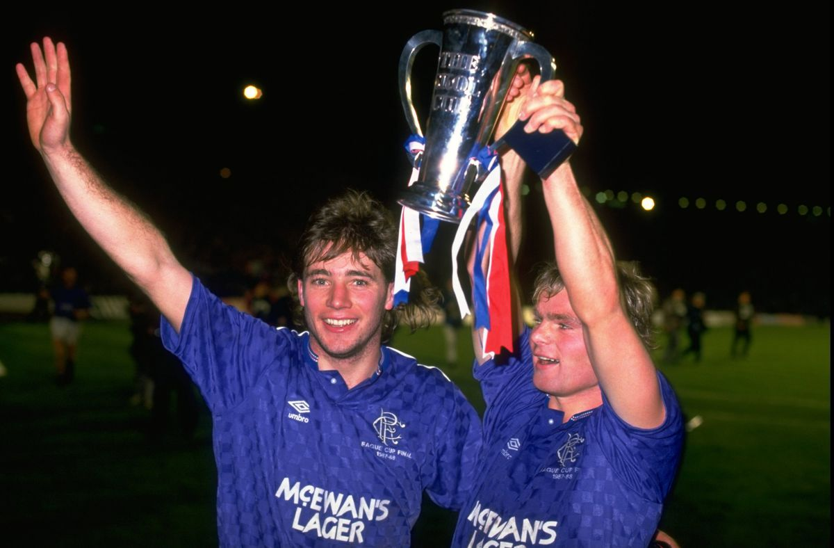 R Fleck and A Mccoist celebrate with the Skol Cup after the finals