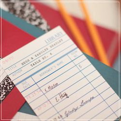 """Library card-themed table assignment from the <a href=""""http://www.uplusudesign.bigcartel.com/product/library-card-escort-card"""">U+U Design Miscellany Shop</a>"""
