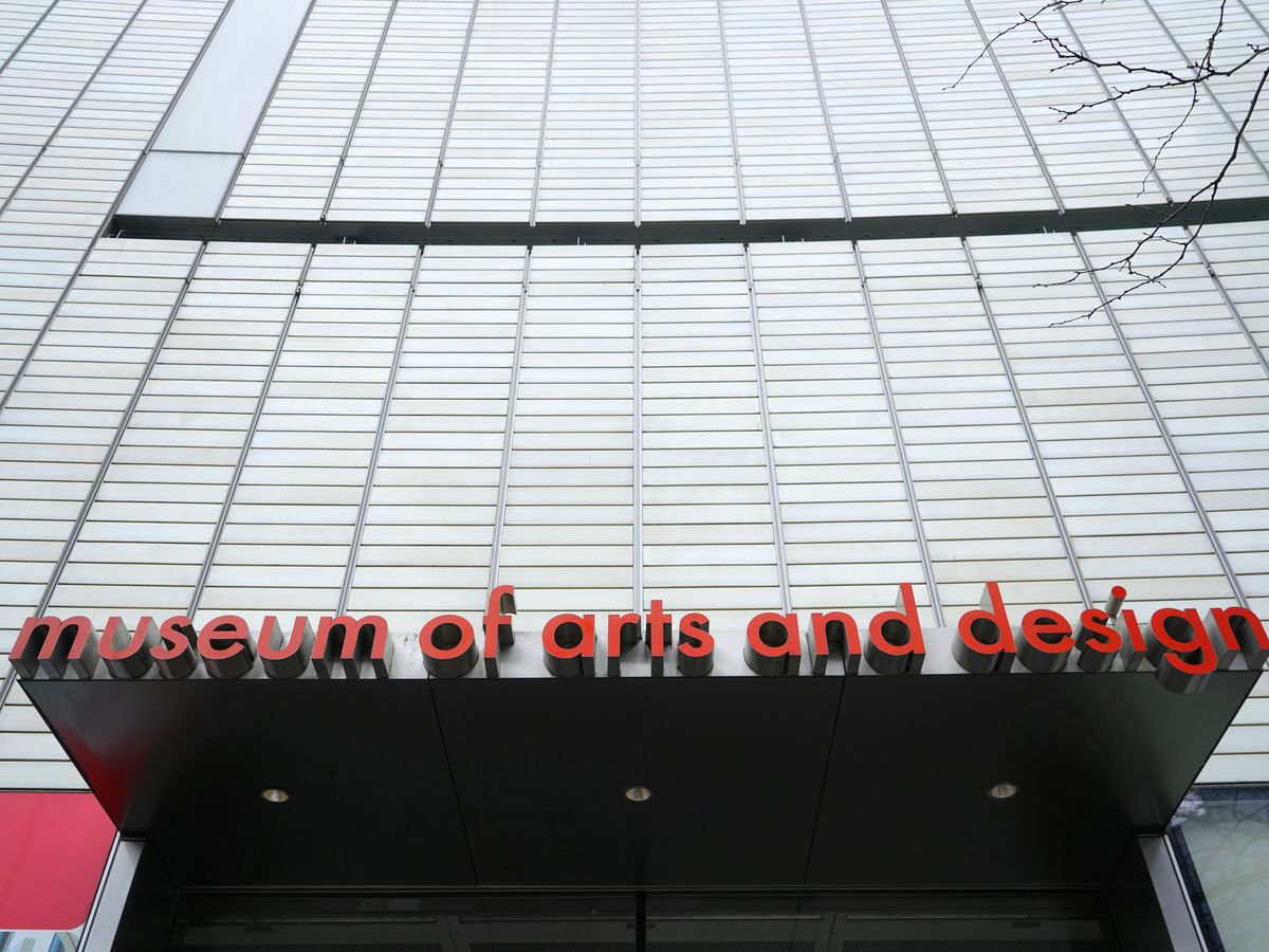 """A building with an awning and a sign that says """"Museum of Arts and Design."""""""