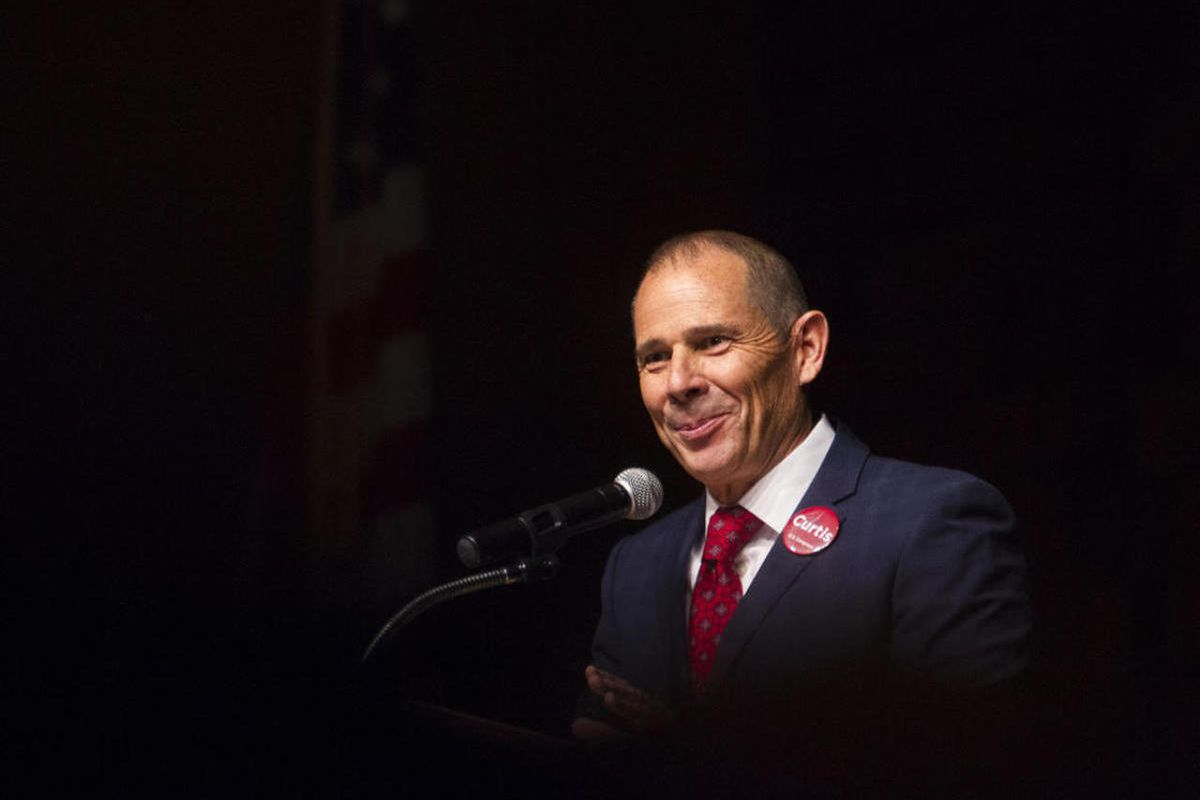John Curtis smiles at the delegates while they applaud his time as mayor during his speech while campaigning for the vote of Republican 3rd District Delegates on the stage at Timpview High School Provo on Saturday, June 17, 2017.