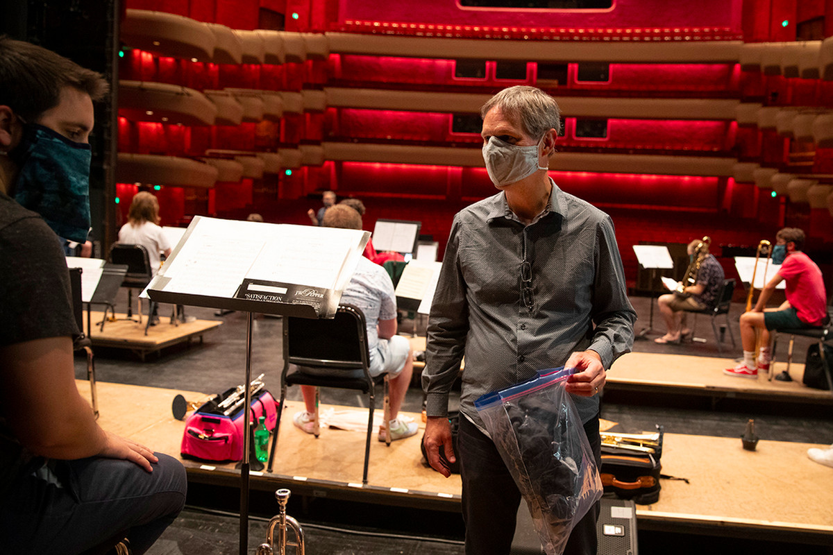 Indiana University Jacobs School of Music professor Tom Walsh works with students during rehearsal in Bloomington, Indiana. His mother — who made his clothes when he was a kid — has sewn more than 80 of the musical masks for free.