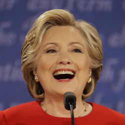 Democratic presidential nominee Hillary Clinton laughs during the presidential debate with Republican presidential nominee Donald Trump at Hofstra University in Hempstead, N.Y., Monday, Sept. 26, 2016.