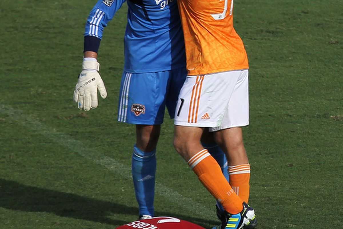 FRISCO, TX - SEPTEMBER 24:  Andre Hainault #31 of the Houston Dynamo and Tally Hall #1 celebrate a win against FC Dallas at Pizza Hut Park on September 24, 2011 in Frisco, Texas.  (Photo by Ronald Martinez/Getty Images)