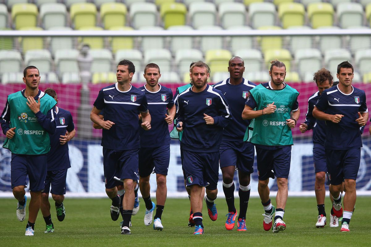 GDANSK, POLAND - JUNE 9:  Daniele De Rossi (C) of Italy leads on a warm up lap during a UEFA EURO 2012 training session at the Municipal Stadium on June 9, 2012 in Gdansk, Poland.  (Photo by Michael Steele/Getty Images)