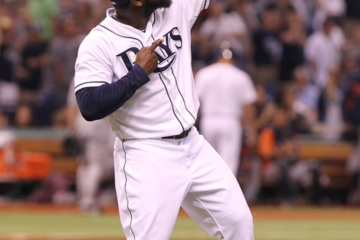 June 29, 2012; St. Petersburg, FL, USA; Tampa Bay Rays relief pitcher Fernando Rodney (56) reacts after they beat the Detroit Tigers at Tropicana Field. Tampa Bay Rays defeated the Detroit Tigers 4-2. Mandatory Credit: Kim Klement-US PRESSWIRE