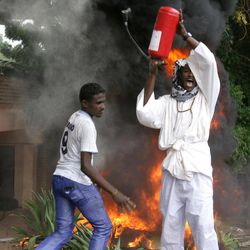 A Sudanese protester raises a fire extinguisher during a demonstration in Khartoum, Sudan, Friday, Sept. 14, 2012, as part of widespread anger across the Muslim world about a film ridiculing Islam's Prophet Muhammad. Germany's Foreign Minister says the country's embassy in the Sudanese capital of Khartoum has been stormed by protesters and set partially on fire. Minister Guido Westerwelle told reporters that the demonstrators are apparently protesting against an anti-Islam film produced in the United States that denigrates the Prophet Muhammad.