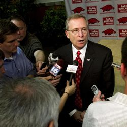 Arkansas athletic director Jeff Long speaks to reporters at an NCAA college football news conference in Fayetteville, Ark., Tuesday, April 24, 2012.