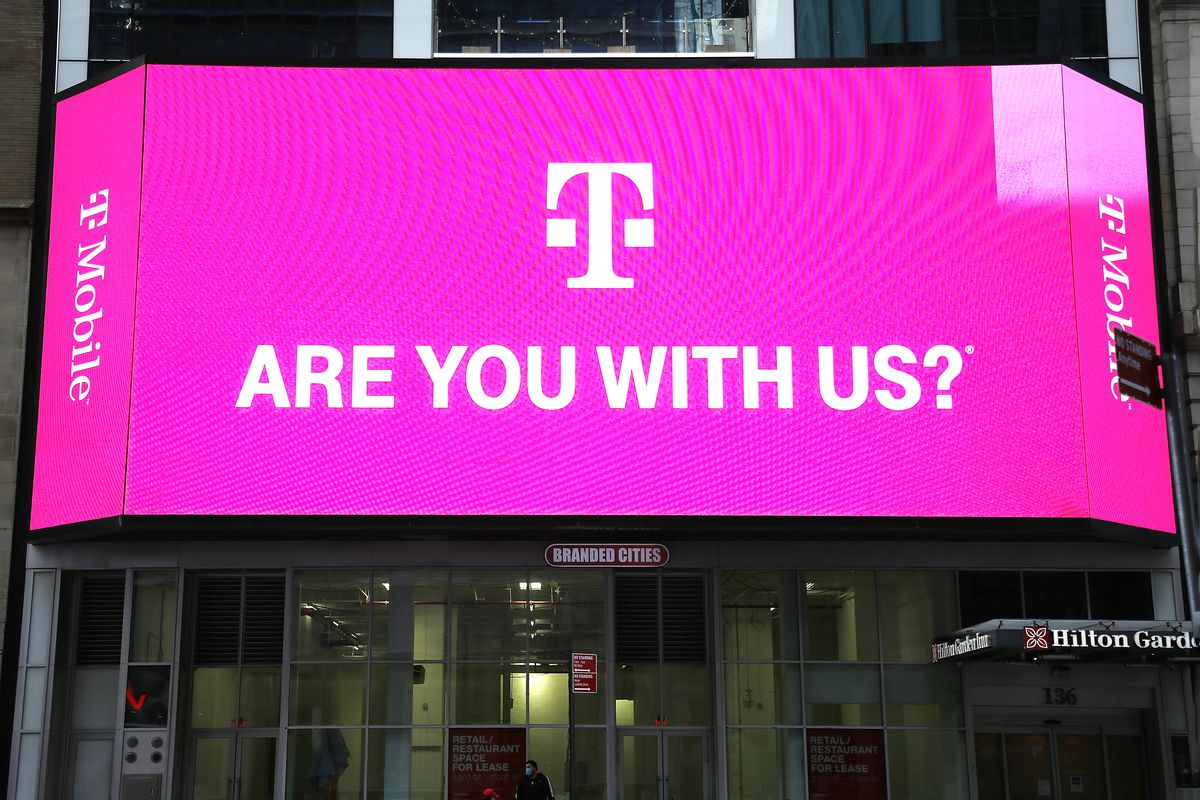 T-Mobile network advertises seen on a Jumbotron in Times...