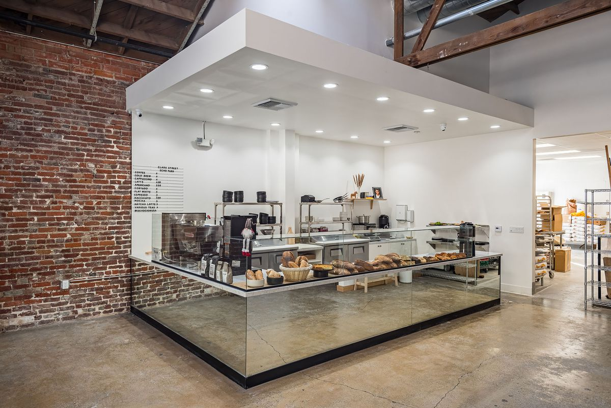 A coffee and pastry station inside a warehouse-like space.