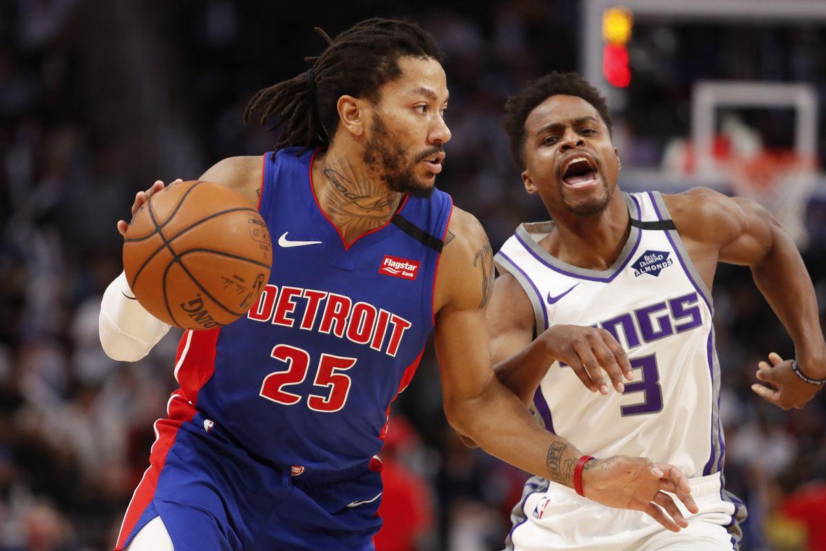 Detroit Pistons guard Derrick Rose dribbles by Sacramento Kings guard Yogi Ferrell during the fourth quarter at Little Caesars Arena.