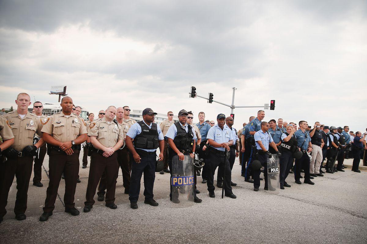 Police block demonstrators near Ferguson, Missouri
