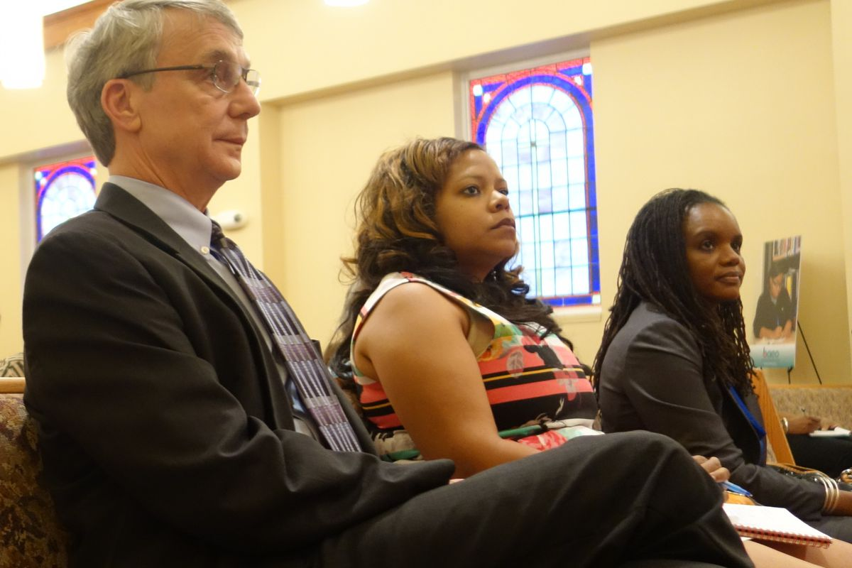 Chris Caldwell (left) and Roshun Austin (right) listen in at community forum for Shelby County Schools candidates on July 14. Many of the same business leaders have donated to their two campaigns, totaling nearly $20,000 each.