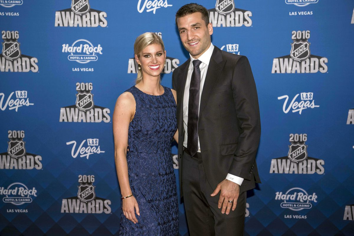 Tasteful and elegant, of course. (Patrice Bergeron and his wife, Stephanie)