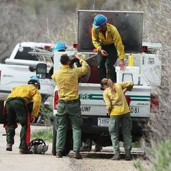 Crews get their gear ready to fight a wildfire burning in the Dutch Hollow area of Midway on Tuesday, May 12, 2020.