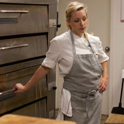 <em>Kerstin Bellah waits on a pie to come out of the oven.</em>