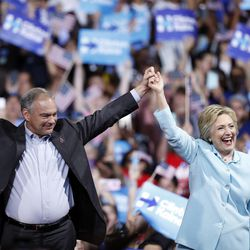 Democratic presidential candidate Hillary Clinton arrives with Sen. Tim Kaine, D-Va., at a rally at Florida International University Panther Arena in Miami on Saturday, July 23, 2016. Clinton has chosen Kaine to be her running mate.