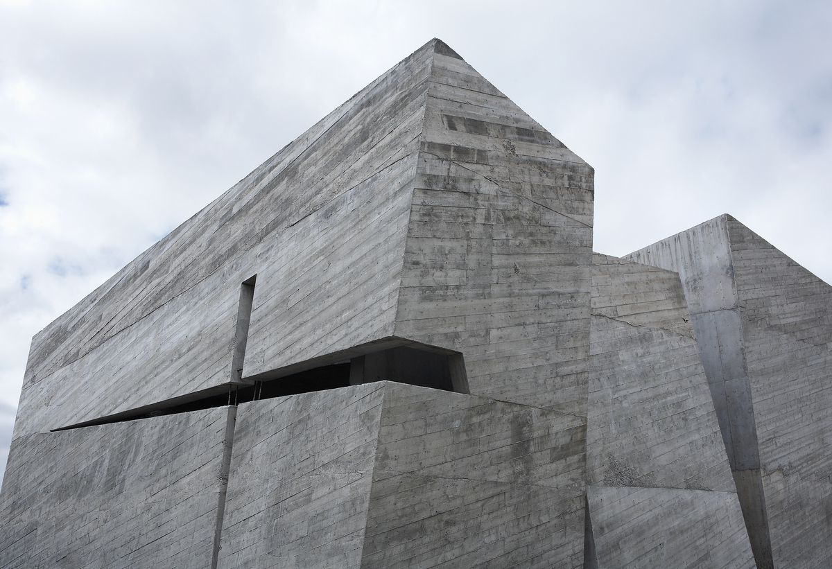 The exterior of the Holy Redeemer Church in Tenerife. The facade is concrete with sliced openings.
