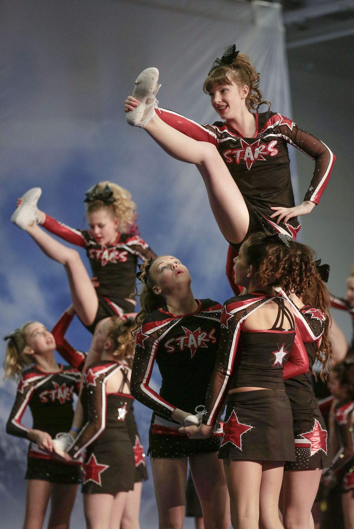 The Evolution Of The Cheerleading Uniform From Bulky Sweaters To