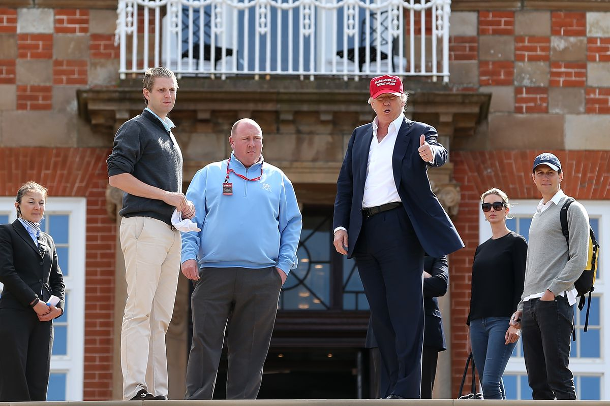 "Trump flashes a thumbs up while wearing a ""Make America Great Again"" hat in front of his Turnberry resort."