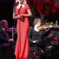 """Guest artist Katherine Jenkins performs with Mormon Tabernacle Choir and Orchestra at Temple Square during a dress rehearsal Thursday. """"There's something about music ... that can make you feel something so deeply that can move you to tears and wake you up,"""" the Welsh singer said."""