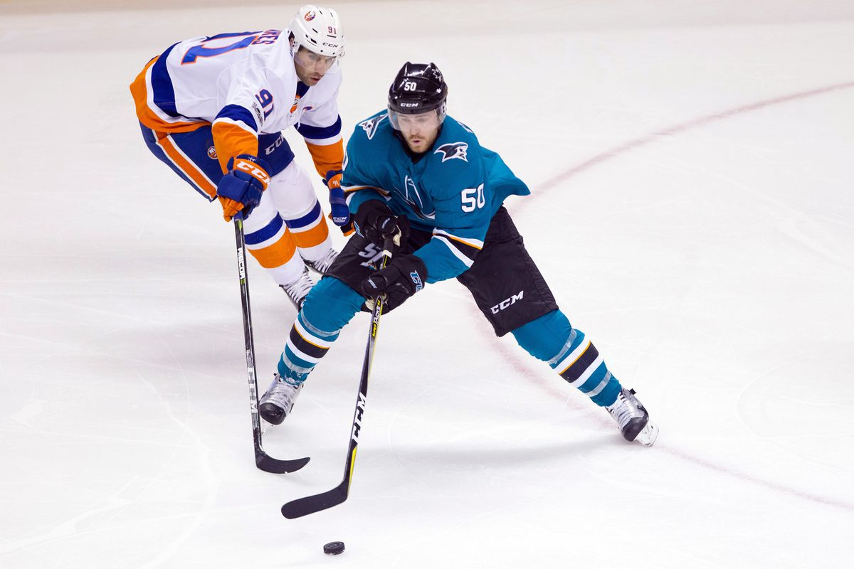 Chris Tierney battles for a loose puck