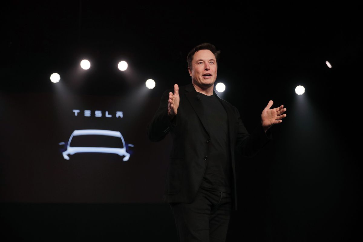 FILE- In this March 14, 2019, file photo Tesla CEO Elon Musk speaks before unveiling the Model Y at Tesla's design studio in Hawthorne, Calif. Musk appears poised to transform the company's electric cars into driverless vehicles in a risky bid to realize