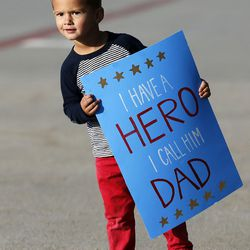 Roman Thornley looks for his father, Staff Sgt. Nick Thornley, as soldiers from Detachment 2, 101st Airborne Division (Air Assault) return to Utah on Friday, Nov. 18, 2016, following an 11-month deployment to Iraq.