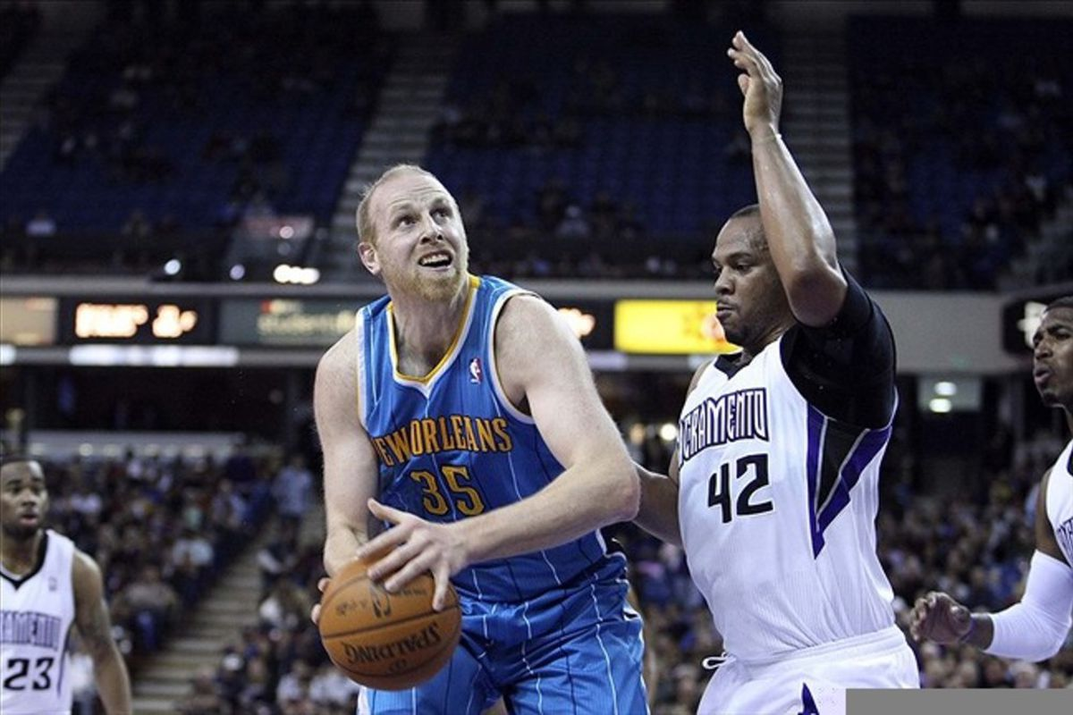 March 7, 2012; Sacramento, CA, USA; New Orleans Hornets center Chris Kaman (35) looks to the basket against Sacramento Kings center Chuck Hayes (42) during the first quarter at Power Balance Pavilion. Mandatory Credit: Kelley L Cox-US PRESSWIRE