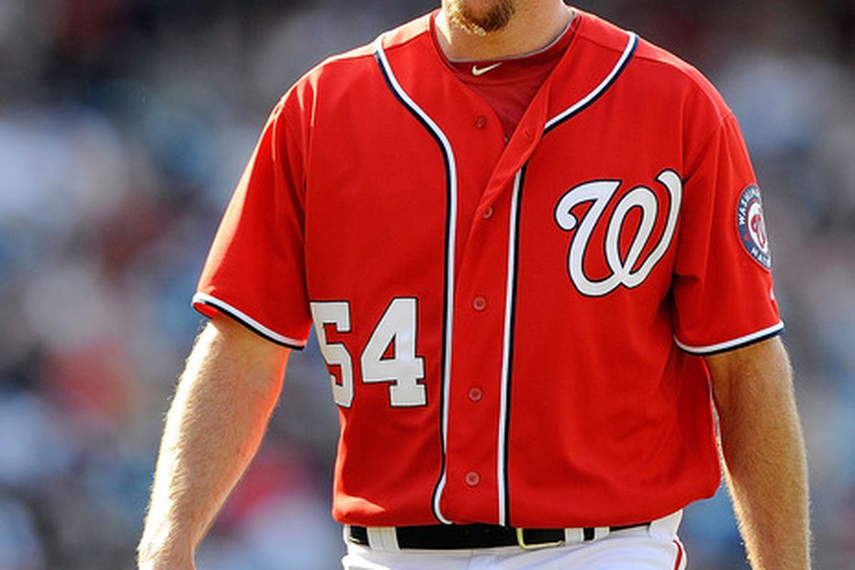 WASHINGTON, DC - JUNE 16:  Brad Lidge #54 of the Washington Nationals walks of the field during the fourteenth inning against the New York Yankees at Nationals Park on June 16, 2012 in Washington, DC.  (Photo by Patrick McDermott/Getty Images)