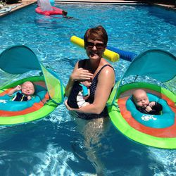 From left, triplets Abraham, Christian and Brady enjoy chilling in the pool with their mom.