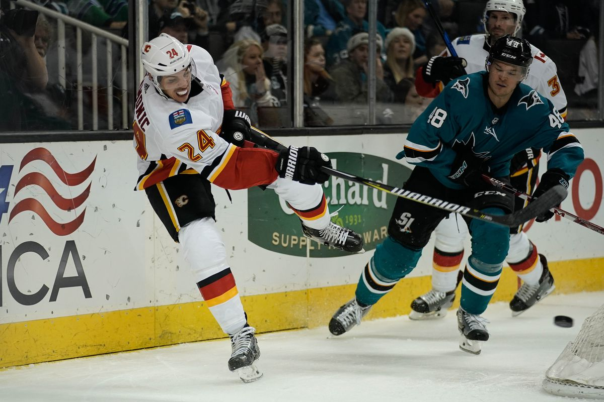 Dec 28, 2017; San Jose, CA, USA; Calgary Flames defenseman Travis Hamonic (24) passes the puck in the game against the San Jose Sharks during the second period at SAP Center at San Jose