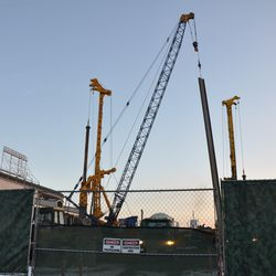 Steel beam being lowered into the triangle lot, seen from Waveland